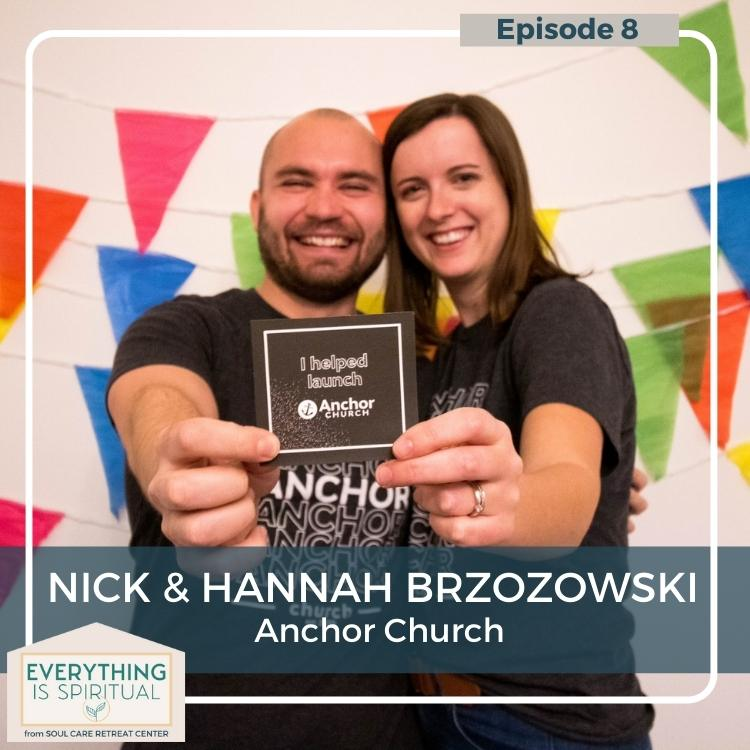 """Nick and Hannah with arms around each other. they each have an arm out towards the camera and are holding one side of a small brown square card that says """"I helped launch Anchor Church"""""""